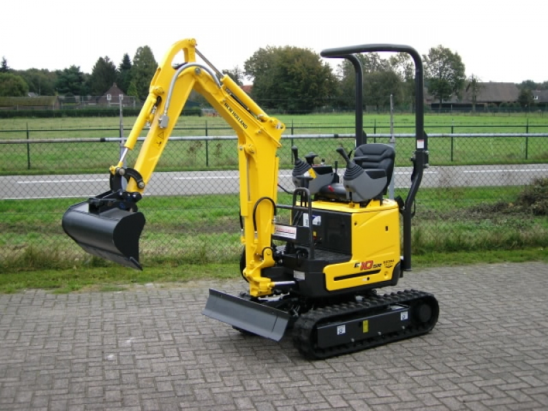 New Holland minigraver 1000 kg.